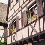 Old half timber (fachwerk) windows on house in Colmar, France. — Stock Photo #57576847