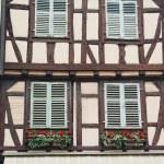 Old half timber (fachwerk) windows on house in Colmar, France. — Stock Photo #57576863