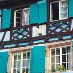 Old half timber (fachwerk) windows on house in Colmar, France. — Stock Photo #57576871