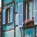 Old half timber (fachwerk) windows on house in Colmar, France. — Stock Photo #57576885