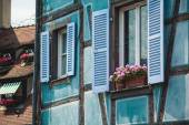 Old half timber (fachwerk) windows on house in Colmar, France. — Stock Photo