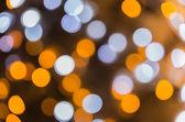 Intreepupil lichten van kerstboom. Bokeh achtergrond — Stockfoto