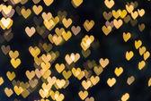 Small golden hearts bokeh background, abstract bokeh — Stock Photo