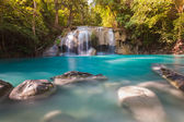 Blue stream waterfall locate in Erawan Nation Park — Stock Photo