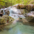Water fall in spring season located in deep rain forest jungle — Stock Photo #61868943
