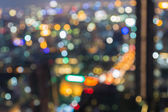 Night- Blurred Photo bokeh of Central business center — Foto Stock