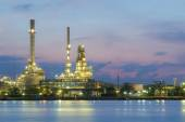 Oil refinery factory river front twilight — Stock Photo