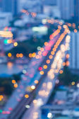 Aerial view of blur bokeh city background — Stock Photo