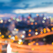 Blur lights of city road with city background — Stock Photo #75397167