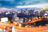 Blur lights of city road with city background — Stock Photo