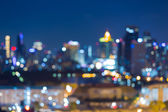 City lights blur bokeh background — Stock Photo