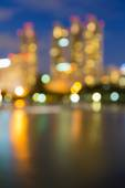 Abstract blur bokeh city lights during twilight, with water reflection — Stock Photo