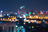 City light blurred bokeh skyline at night — Stock Photo