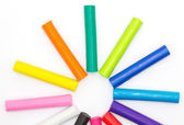 Rainbow coulor modelling clay sticks on white background — Stock Photo