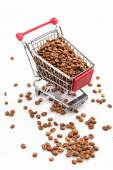 Coffee in small shopping cart — Stock Photo