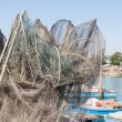 Fishing nets, creels and fishing boats — Stock Photo #56007343
