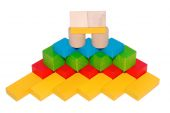 Hand-made article from multi-colored children's cubes — Stock Photo