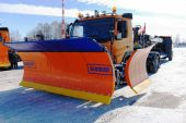 Nizhny Novgorod. Russia. February 17, 2015. The SCHMIDT snowplow with the ladle put in transport situation — Stock Photo