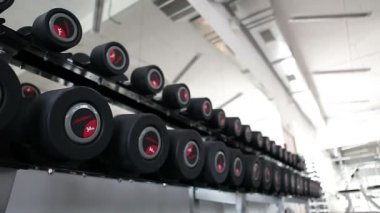 Sports dumbbells rubber in modern sports club. Weight Training Equipment. Camera in motion — Stock Video