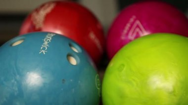 Multi-colored bowling balls — Stock Video