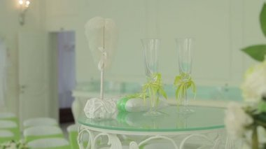 Table with wedding accessories and two glasses — Stock Video