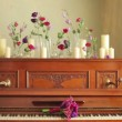 Old beautiful piano with bouquets of flowers and candles — Stock Video #60629073