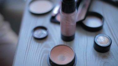 A closeup, makeup  table with makeup equipment — Стоковое видео
