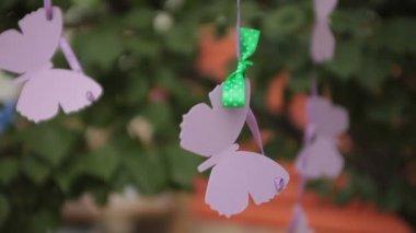 Hanging  paper butterflies outdoor — Stockvideo