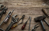 Old tools on a wooden table — Stock Photo