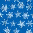 Seamless winter background with snowflakes on blue background. Vector — Stock Vector #57228633