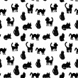 Seamless pattern Black cats silhouettes on white background. vector — Stock Vector #59411815