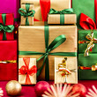 Three Piles of Xmas Gifts in Red, Gold and Green — Stock Photo #52228375
