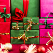 Three Stacks of Xmas Presents Arranged by Color — Stock Photo