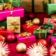Numerous Xmas Gifts Arranged on a Red Cloth — Stock Photo #52233001