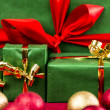 Four Xmas Presents with Bows in Gold and Red — Stock Photo #52235073