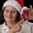 Smiling Aged Woman Holding and Pointing at Red Gif — Stock Photo #52658391