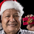Aged Gentleman with Red Cap Holding Small Gift — Foto Stock #52661287