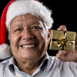 Old Gentleman With Red Hat Offering Golden Gift — Stock Photo #52661511