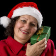 Senior Lady with Santa Claus Hat and Wrapped Gif — Stockfoto #55483263