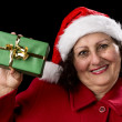Elderly Woman Holding up a Green Wrapped Xmas Gif — Stock fotografie #55483351