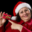 Joyful Aged Lady Pointing at Red Christmas Gif — Stock Photo #55495269