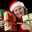 Elderly Woman with Three Wrapped Christmas Gift — Stock Photo #55496615