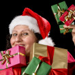 Perky Female Pensioner Presenting Wrapped Gift — Stock Photo #55497953