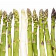 One White Asparagus Spear Among Twelve Green Ones — Stock Photo #55924801
