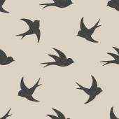 Silhouette style flying swallows seamless pattern — Stock Vector