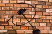 Hammer and sickle, graffiti on the bricks wall — Zdjęcie stockowe