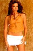 Tan Top - White Skirt - Tan Fuzzy Background - Front View - Brunette Professional Model — Foto de Stock