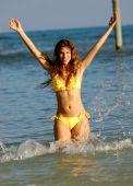Splashing in the Ocean - Blue Water - Beautiful Model - Yellow Bikini — Stock Photo