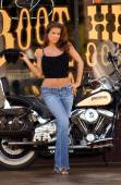 Sexy woman posing with motorcycle — Stock Photo