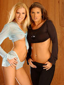 Best Friends - Blue and Black Outfits - Tan Background — Stock Photo